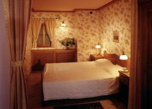 A bed or beds in a room at Vincent