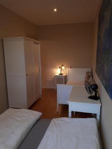 A bed or beds in a room at Holidayapartments Marquardt