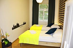 Кровать или кровати в номере Navrátilova Apartment 4you