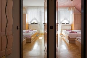 A bed or beds in a room at Apartments Bohinj Mavrica