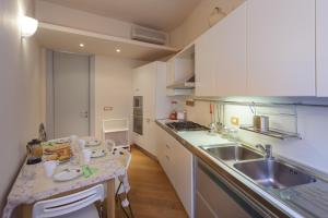 A kitchen or kitchenette at Casa Sophie- Big Terrace sea View & Private Parking