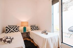 A bed or beds in a room at City Center Sevilla ARCO MACARENA
