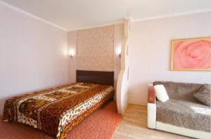 A bed or beds in a room at 175А проспект имени газеты Красноярский Рабочий