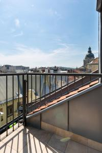 A balcony or terrace at The Cathedral Rooftop Terrace