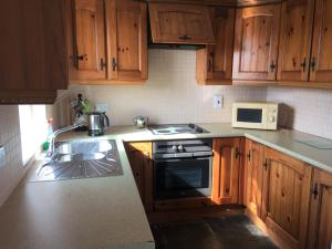 A kitchen or kitchenette at Baile Slievemore Holiday Homes