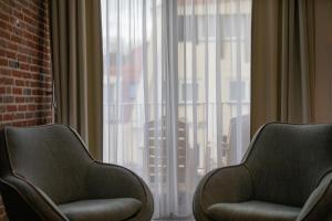 Ein Sitzbereich in der Unterkunft Appartementen Zeerust