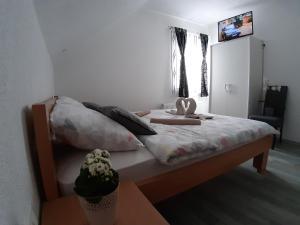 Un ou plusieurs lits dans un hébergement de l'établissement House Betty
