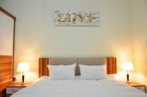 Postel nebo postele na pokoji v ubytování Al Muntaza building 101