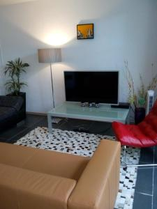 A television and/or entertainment centre at Jordaan Canal View Apartment