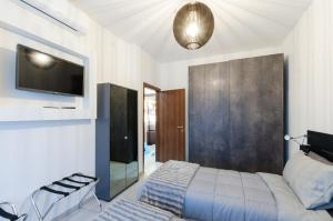 A bed or beds in a room at Appartamento moderno San Siro