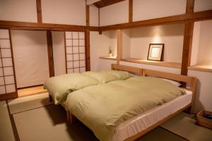 一棟貸切宿「茶心」にあるベッド