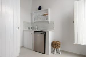 Una cocina o zona de cocina en Vallas Apartments & Villas