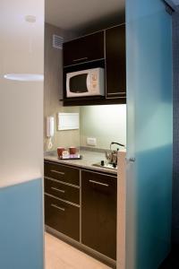 A kitchen or kitchenette at Recoleta Apartments