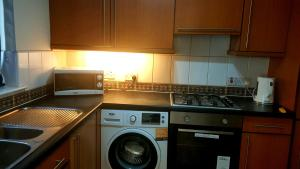 A kitchen or kitchenette at Partick Apartment