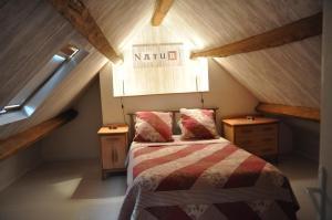 Un ou plusieurs lits dans un hébergement de l'établissement Gîtes de L'Oasis
