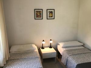 A bed or beds in a room at Appartamenti Le Mimose