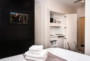 A bed or beds in a room at MStay Golders Green