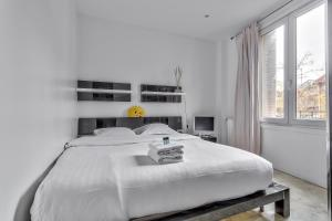 A bed or beds in a room at ⚶ Close to the quays of Seine ⚶ 16 th Arr.
