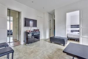 A television and/or entertainment center at ⚶ Close to the quays of Seine ⚶ 16 th Arr.