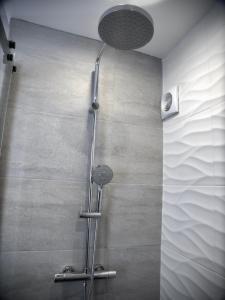 A bathroom at NuitéeJour Le Mans