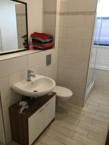 Vonios kambarys apgyvendinimo įstaigoje Cityflair Apartments