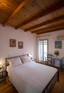 A bed or beds in a room at Nostos Hotel