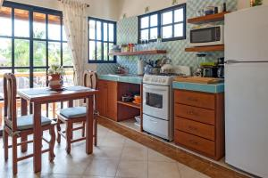 A kitchen or kitchenette at Righetto Vacation Rentals
