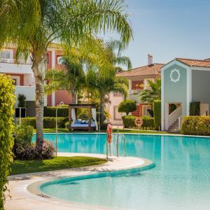 The swimming pool at or near Cortijo Del Mar Resort