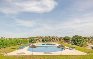 A view of the pool at O Refugio Alentejano or nearby