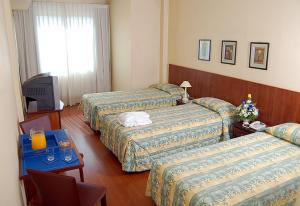 A bed or beds in a room at Imperio Suites Hotel & Apart