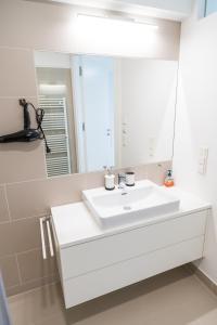 A bathroom at Luxus Maisonette Liechtenstein by welcome2vienna