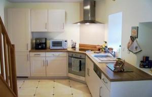Cuisine ou kitchenette dans l'établissement Gîte Le Galta