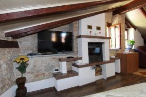 A television and/or entertainment center at Studio Isabel