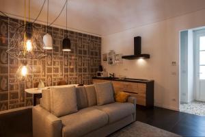 Ein Sitzbereich in der Unterkunft Le Tre Madame