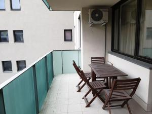 A balcony or terrace at Corvin Apartment Budapest