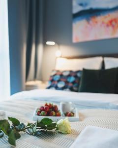 A bed or beds in a room at Airport Bakalarska P&O Serviced Apartments