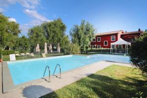 The swimming pool at or near Agri-tourism Casolare dei Fiori Montecarlo - ITO041001-DYB