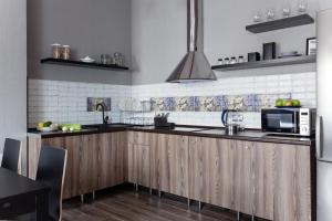 Cucina o angolo cottura di Shaulis Apartment on Nevsky 117