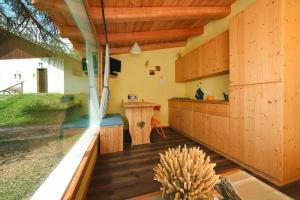 A kitchen or kitchenette at Holiday resort Fiemme Village Ballamonte di Predazzo - IDO01301-MYC