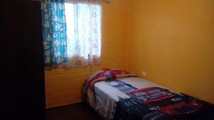 A bed or beds in a room at Arriendo para el eclipce solar