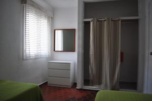 A bed or beds in a room at Atlas Apartments Ibiza