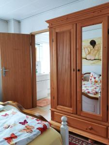 A bed or beds in a room at Ferienwohnungen Ludolph
