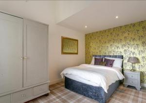 Ένα ή περισσότερα κρεβάτια σε δωμάτιο στο Kenilworth House