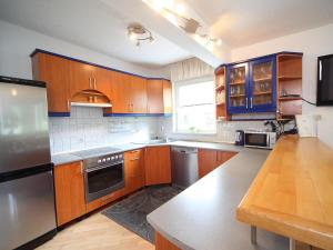 A kitchen or kitchenette at Apartments and Rooms Jozica