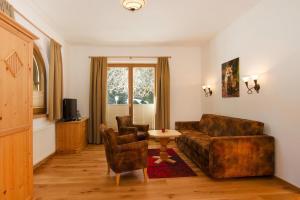 A seating area at Apartments Landhof Ellmau Ellmau - OTR06502-EYD