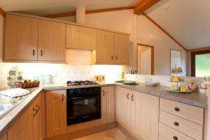 A kitchen or kitchenette at Crocus Lodge