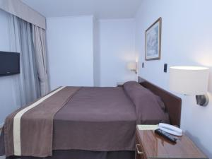 A bed or beds in a room at Apart Hotel Diego De Almagro
