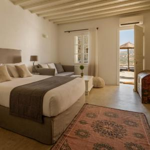 A bed or beds in a room at Cova Mykonos Suites