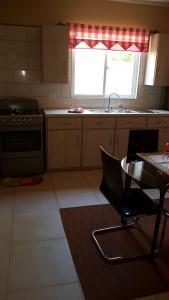 A kitchen or kitchenette at Mahuma Apartments