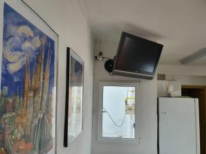 A television and/or entertainment center at Barcelona Apartments Rent